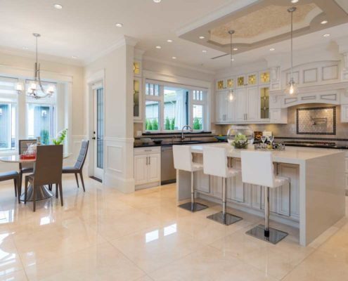 Open concept kitchen and dining areas in this executive home.