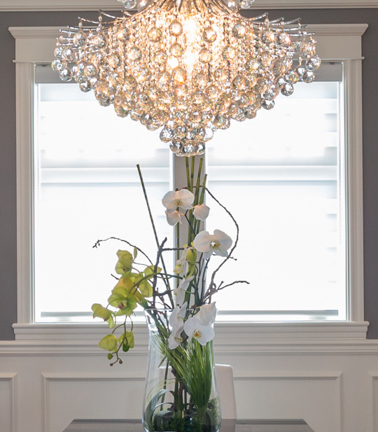 Close-up of chandelier and flowers.