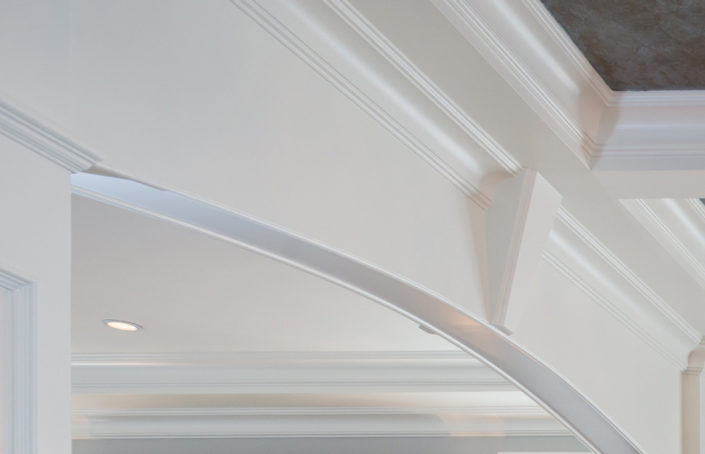 Close-up of woodwork detail on custom home ceiling.