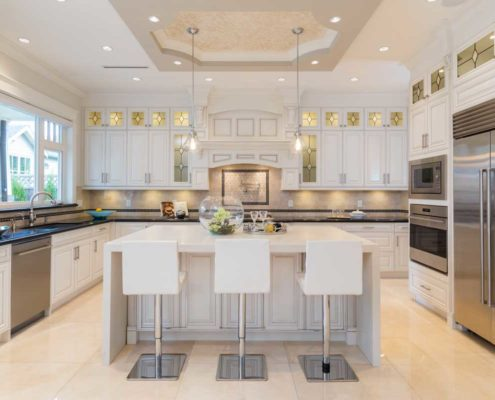 Elegant kitchen with beautiful stained glassed cabinets.