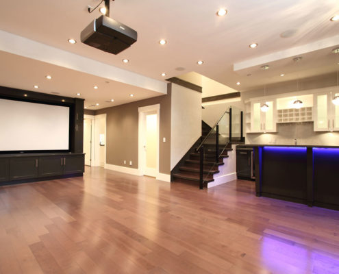 Arbutus home with large basement entertainment area and projector TV.