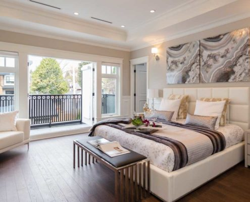 Master bedroom with french doors leading out to deck.