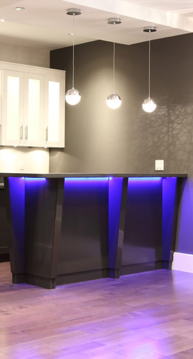 Dramatic under-counter lighting in this home bar in Vancouver.
