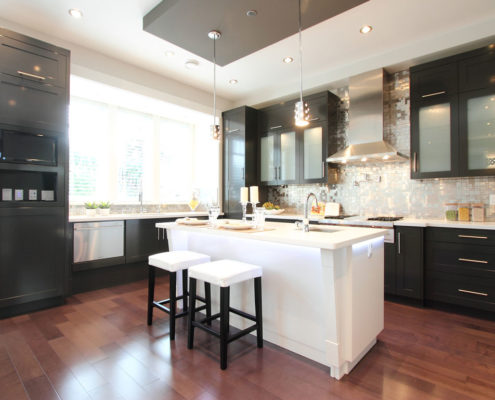 Contemporary kitchen with kitchen island in Arbutus custom built home.