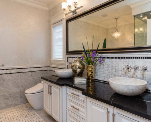 Stylish en suite bath with his and her sinks.