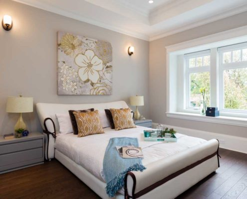 Classically styled bedroom with tray ceiling.
