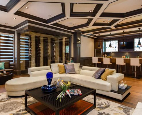 Glassed-in wine cellar in entertainment room.