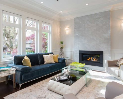 White marble fireplace modernize this white living room.