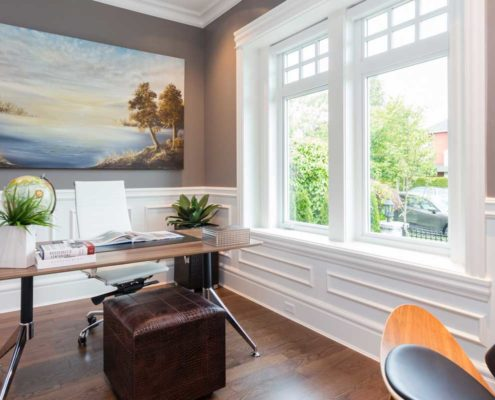 Sleek and stylish home office with large window.