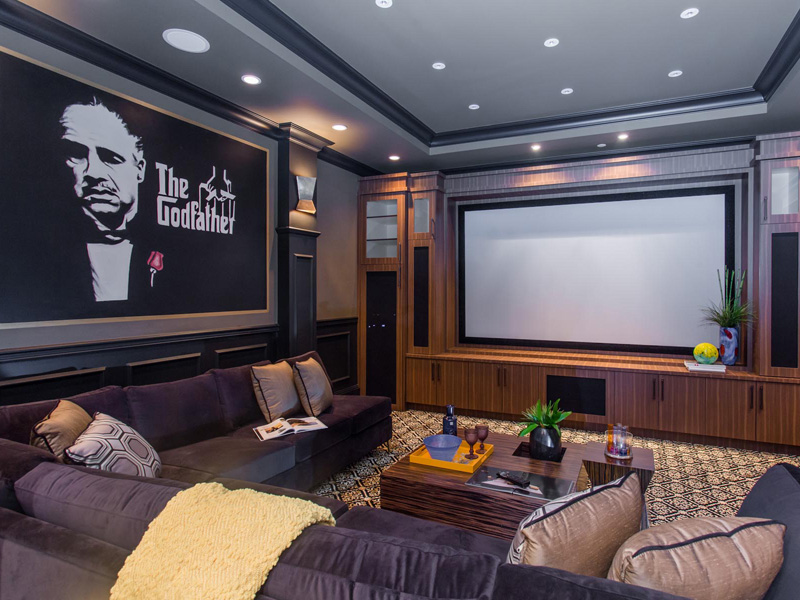 Dramatic entertainment room with large movie screen in Kitsilano custom home.
