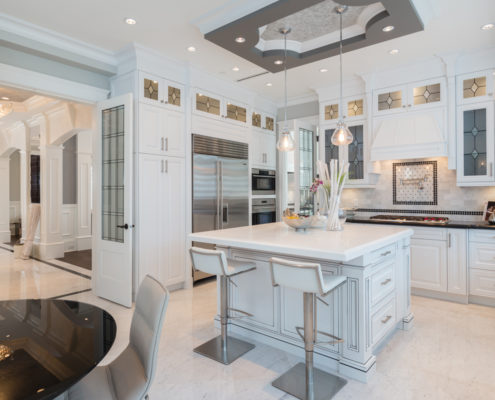 Bright white kitchen with tray ceiling.
