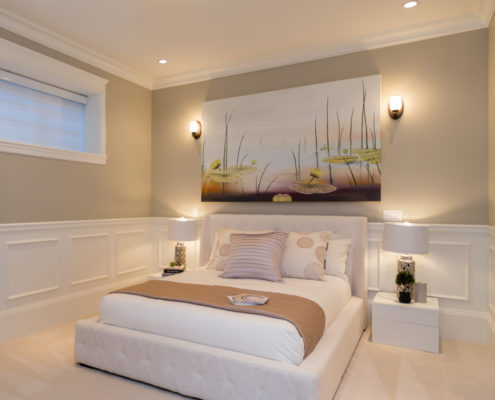 Basement bedroom with lily pad artwork.