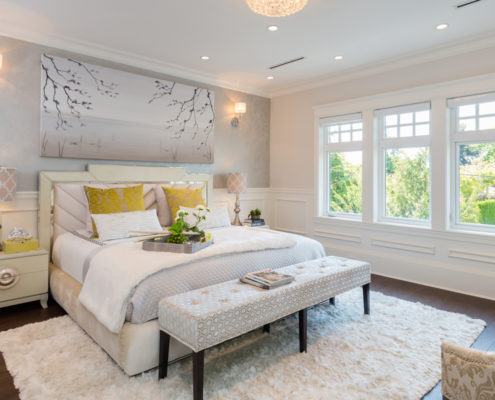 Bright and white master bedroom with ensuite bath.