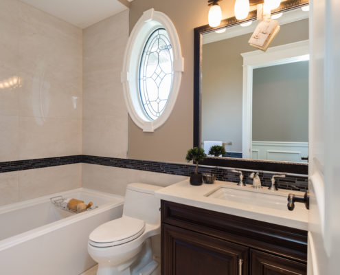 Oval window accents guest bath