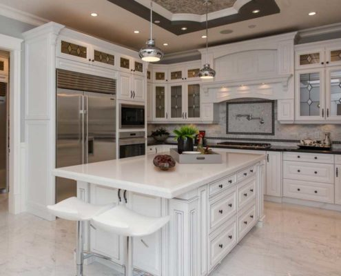 Modern, white kitchen with large kitchen island.