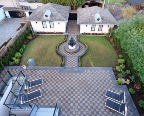 Vancouver backyard patio with checkered tile flooring.