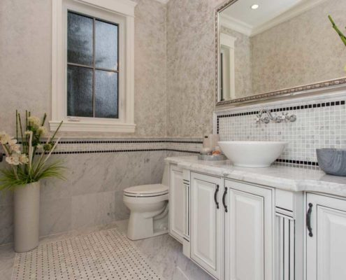 Tiled powder room in custom home.