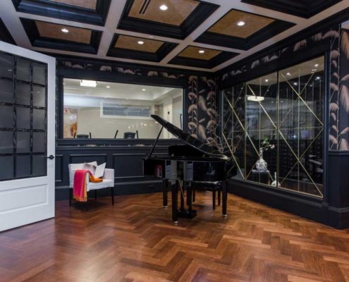 Breathtaking recreation room with grand piano in Kitsilano custom home.
