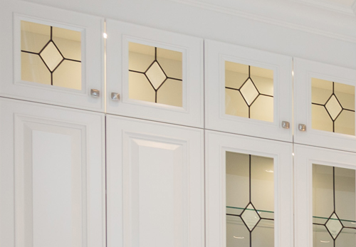 Leaded glasswork on kitchen cabinets.