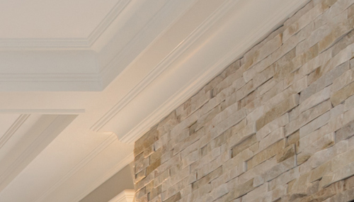 Close-up of crown moulding and fireplace brick work.