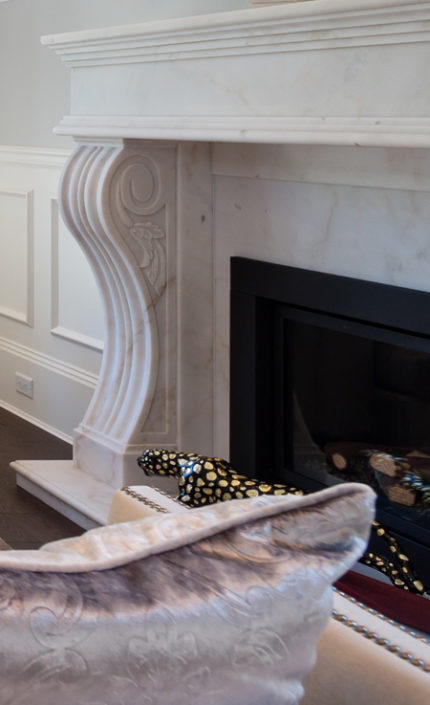 Marble detail of fireplace surround.