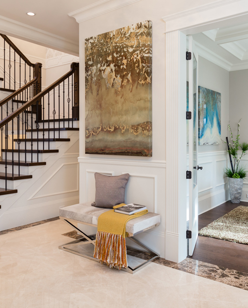 Welcoming foyer of executive home.