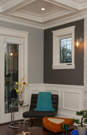 High-end family room with wall panel detail.