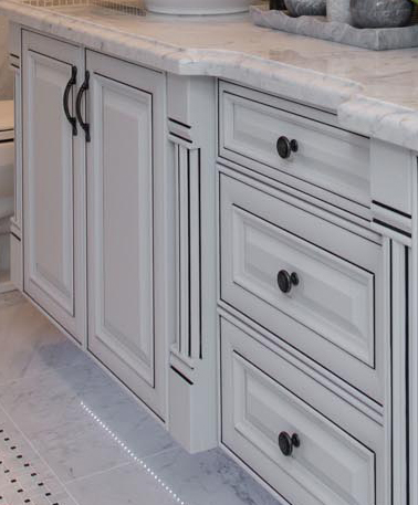 Fine wood cabinets in master ensuite bath.
